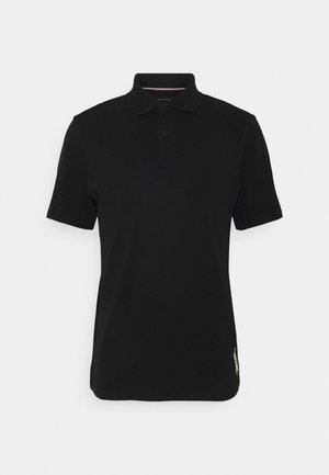ONE PLANET BACK LOGO UNISEX - Polo shirt - black