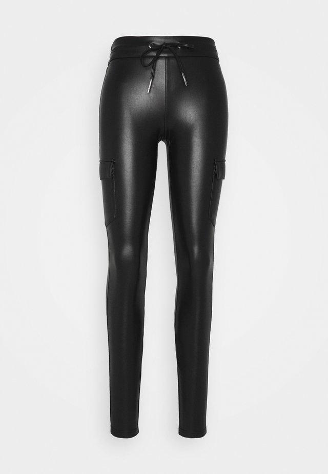ONLZABO STRING - Leggings - black