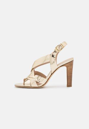 AGNITA - Sandals - or