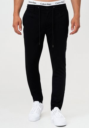 SUPER STRETCH DYER - Trousers - black