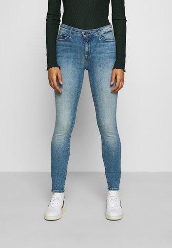 NORA - Jeans Skinny Fit - dynamic mira mid blue