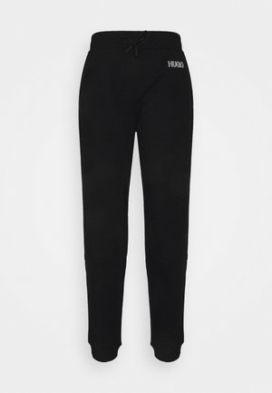 DACHIBI - Tracksuit bottoms - black