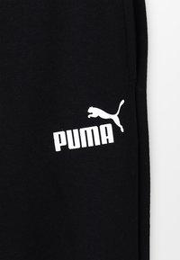 Puma - AMPLIFIED SWEAT PANTS - Tracksuit bottoms - black - 5
