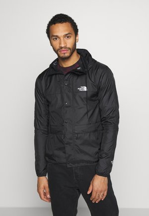 MOUNTAIN  - Windbreaker - black/white