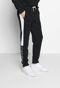 Calvin Klein - OGO STRIPE  - Trainingsbroek - black - 0