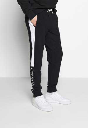 OGO STRIPE  - Tracksuit bottoms - black