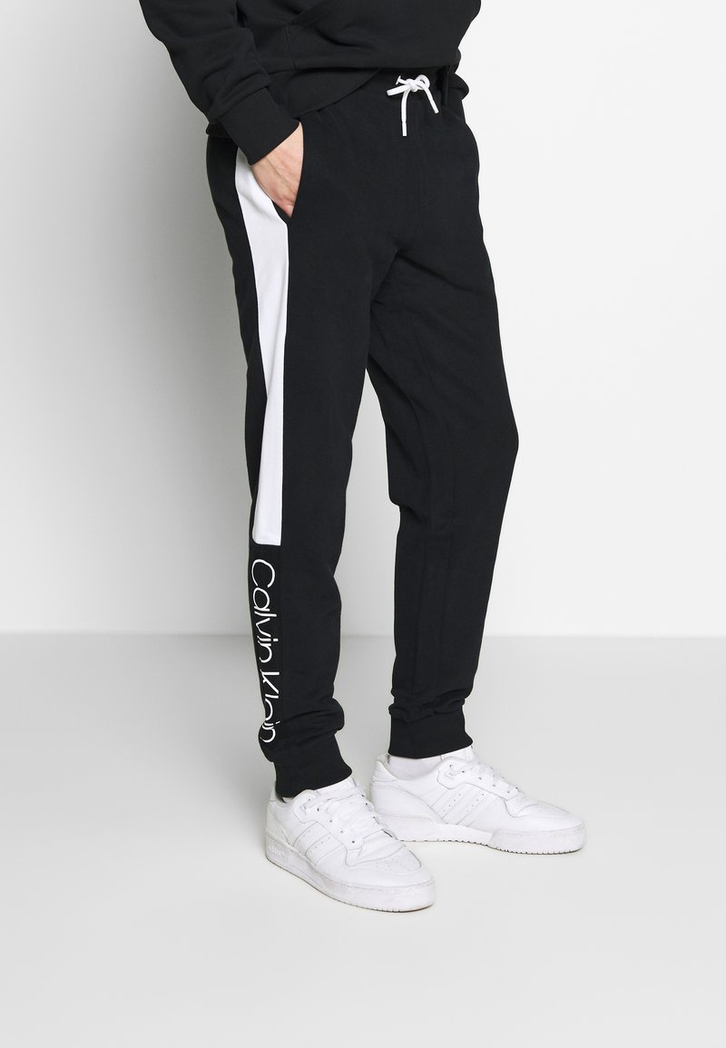 Calvin Klein - OGO STRIPE  - Trainingsbroek - black