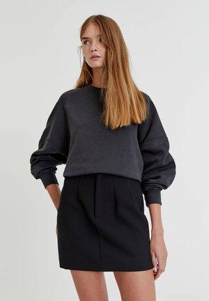 ZIERNÄHTEN - A-line skirt - mottled black