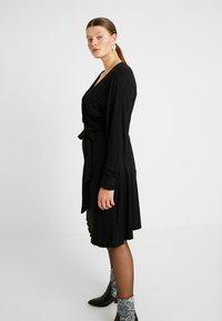 Kaffe Curve - PINA WRAP DRESS - Jersey dress - black deep - 4