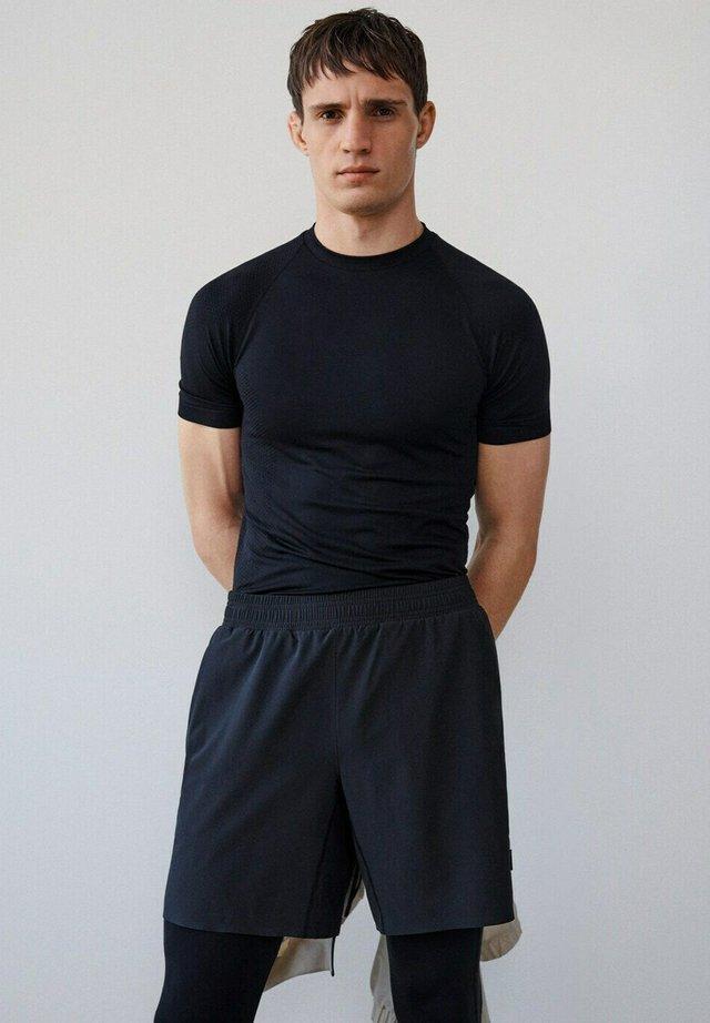 TECHNISCHE - Shorts - schwarz