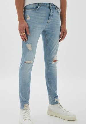 PREMIUM MIT RISSEN - Jeans Skinny Fit - light-blue denim