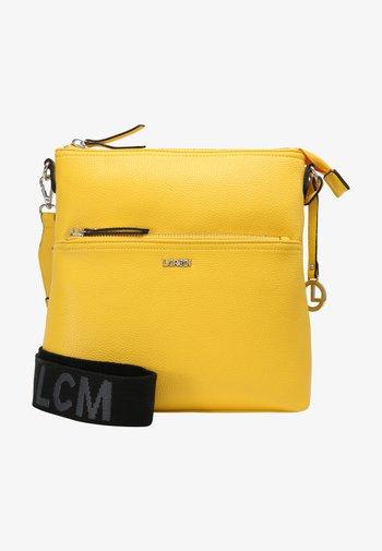 FELICITAS - Across body bag - lemon
