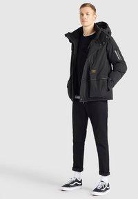 khujo - NANDU - Winter jacket - schwarz-schwarz kombo - 2