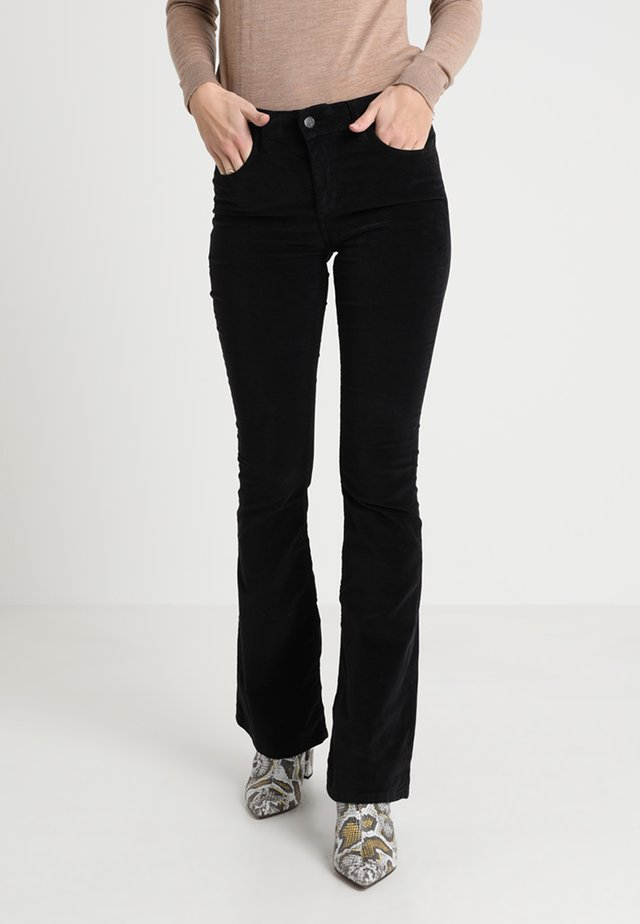 RAVAL SMOOTH - Trousers - black