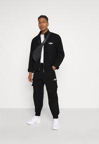 Mennace - CRINKLE TECH TRACKSUIT JACKET - Summer jacket - black - 1