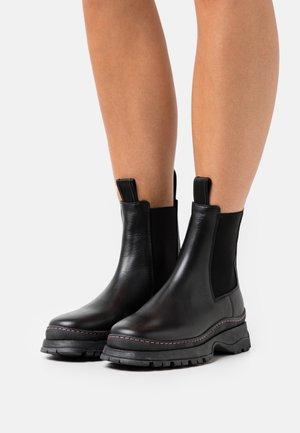 POWDER CHELSEA - Platform ankle boots - black