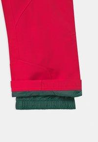 Ziener - ALIN UNISEX - Snow pants - neon pink - 2