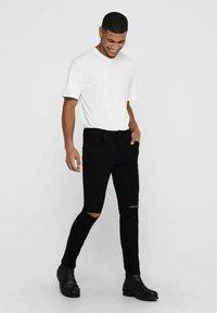 Only & Sons - ONSWARP LIFE KNEECUT - Jeans Skinny Fit - black denim - 1