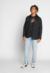 Nike Sportswear - Print T-shirt - black/university red - 1