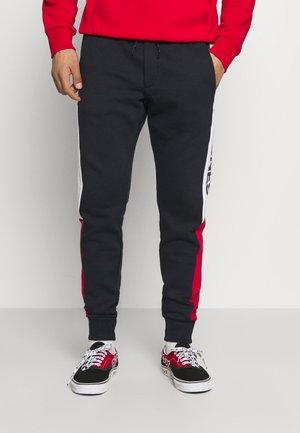 JJIWILL LOGO BLOCKING  - Spodnie treningowe - navy blazer
