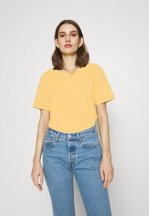 Botanical dyed top - Jednoduché triko - yellow
