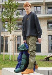 Levi's® - XX TAPER CARGO II - Cargo trousers - olive - 4