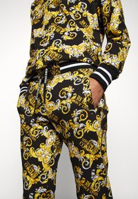 Versace Jeans Couture - FLEECE NEW LOGO - Tracksuit bottoms - nero - 3