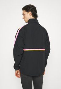 adidas Originals - TAPED ANORAK UNISEX - Windbreaker - black - 2