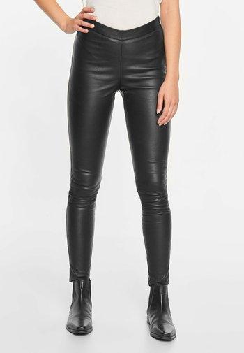 SELMA - Leather trousers - black