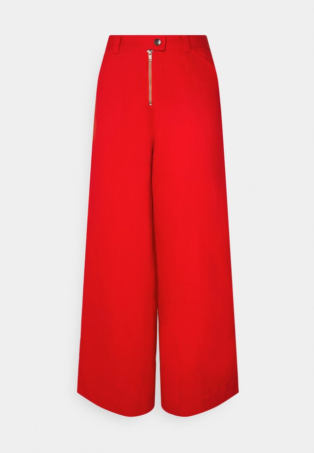 TYLER PANTS - Flared-farkut - red