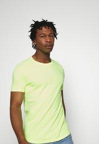 edc by Esprit - NEON DYE - Basic T-shirt - bright yellow - 3