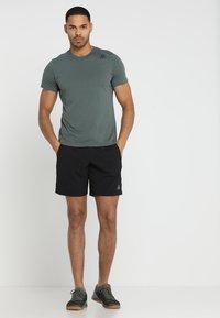 Reebok - WOR SPEEDWICK TRAINING SHORTS - Sports shorts - black - 1