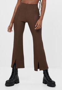Bershka - Trousers - brown - 0
