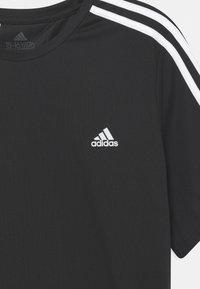 adidas Performance - T-shirt med print - black/white - 2