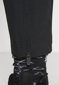 Under Armour - CURRY WARMUP - Teplákové kalhoty - black - 3