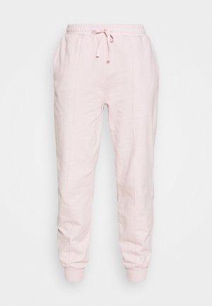 ACID WASH JOGGER - Tracksuit bottoms - pink