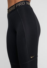 Nike Performance - FIERCE TIGHT - Tights - black/metallic gold - 4