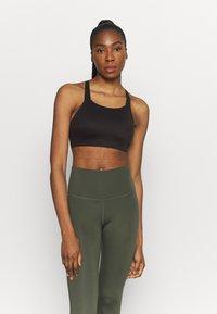 Nike Performance - LUXE BRA - Medium support sports bra - black - 0