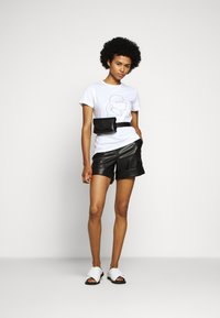 KARL LAGERFELD - Leather trousers - black - 1