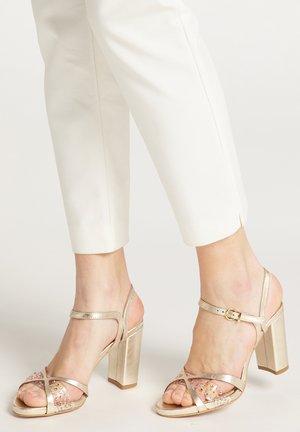 High heeled sandals - gold metallic