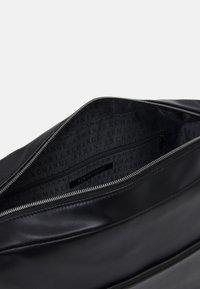 Armani Exchange - MANS CROSSBODY - Across body bag - black/white - 2