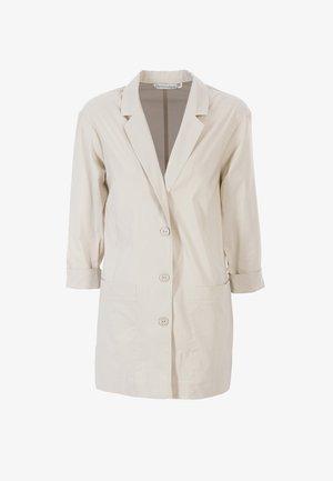 MIT REVERSKRAGEN - Short coat - hellbeige