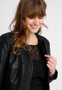 ONLY Carmakoma - CAROKRA  - Faux leather jacket - black - 5