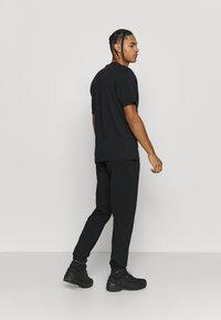 Norrøna - Print T-shirt - black - 2