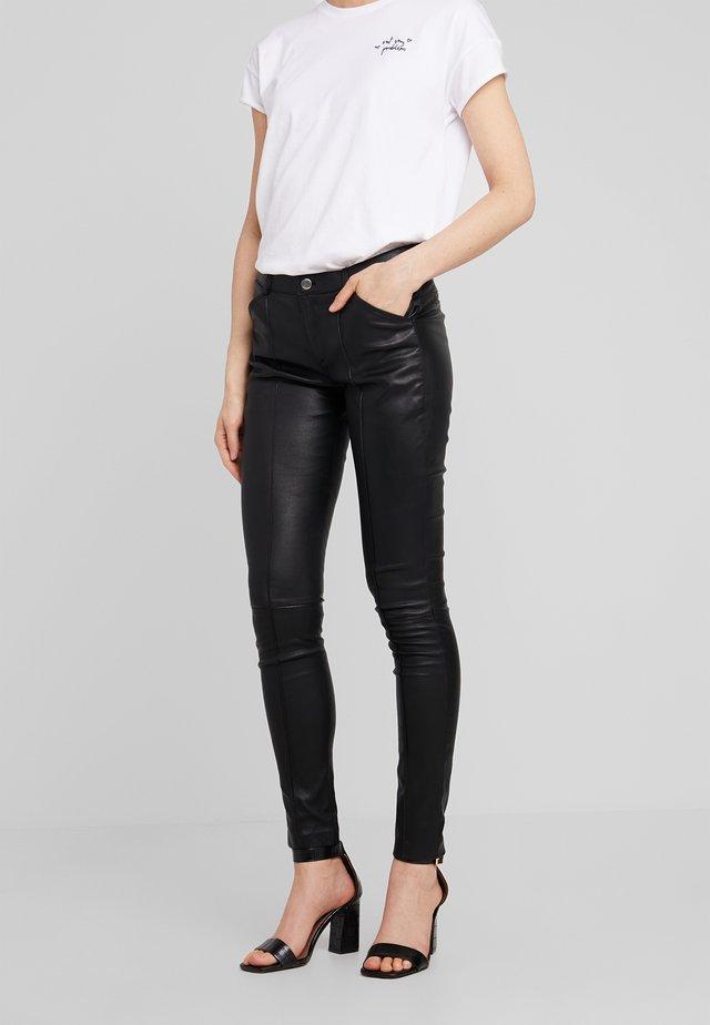 ELIZA - Leather trousers - black