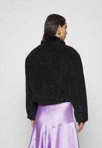 Levi's® - NEW HERITAGE TRUCKR - Winter jacket - black - 2