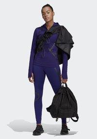 adidas by Stella McCartney - TRUEPACE HOODED LONG SLEEVE MIDLAYER TOP - Bluza z kapturem - purple - 1
