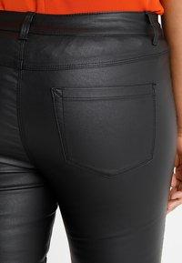 ONLY Carmakoma - CARPUNK SKINNY BIKER COATED  - Trousers - black - 5