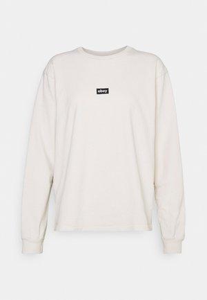 TAG - Pitkähihainen paita - sago