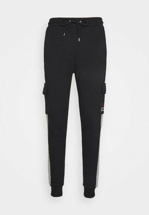TECH UTILITY - Pantalon de survêtement - black